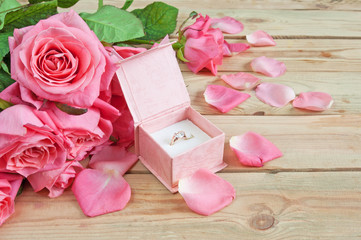 roses bunch and box with ring on wooden background, wedding ring,  betrothal card