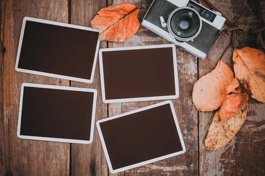 Retro camera with paper photo frame for add picture. memories and nostalgia in fall (Autumn) concept. vintage color effect.