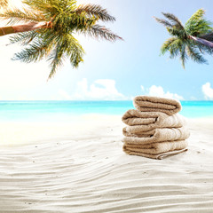 Towel background on sand and free space for your decoration. Summer landscape with palms