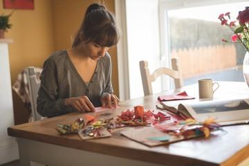 Woman preparing craft at home
