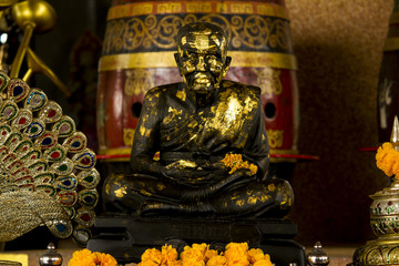 Bronze statue of a meditating monk.