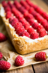 Fresh raspberry cheesecake on the rustic background. Selective focus. Shallow depth of field.