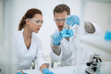 close up.two scientists discuss the results of testing.
