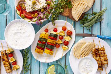 Delicious grilled chicken souvlaki and vegetables skewers.