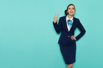 Smiling Stewardess Is Showing Peace Hand Sign