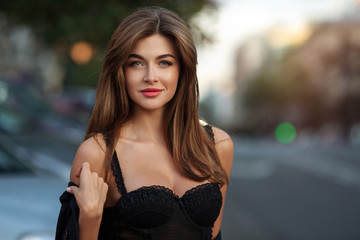 portrait of a beautiful woman against the background of the city