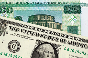 A close up image of a Belorussian 100 ruble note with an American one dollar bill