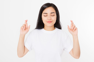 Young asian woman cross fingers for wishing good luck isolated on white background.Template summer t shirt. Copy space