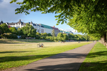 Green lawn and park in the center of Helsinki, Finland, beautiful cityscape, view of the city and the publik park Meripuisto - fototapety na wymiar