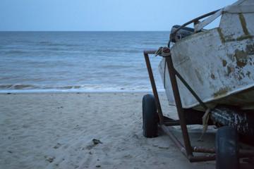 Vintage boat at the coastline against a seascape background.