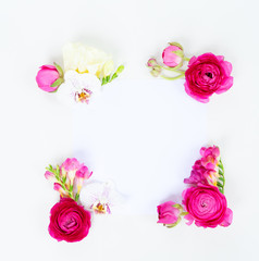 Flowers composition. Frame made of ranunculus and orchidea flowers on white background. Flat lay, top view, copy space