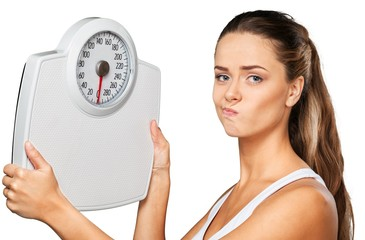 Portrait of an Unhappy Woman Holding a Weight Scale