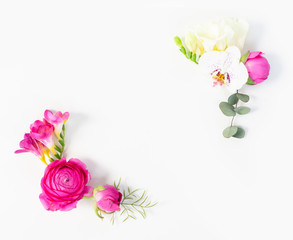 Flowers composition. Frame corners of eucaliptus leaves and ranunculus flowers on white background. Flat lay, top view, copy space