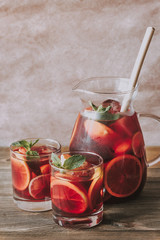 A pitcher and two glasses with Spanish fruit Sangria