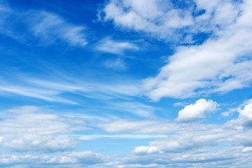 beautiful white clouds on the background of bright blue sky.