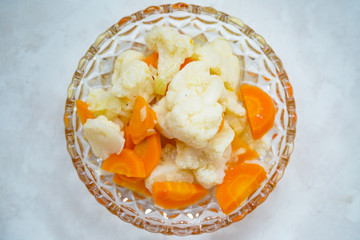 Simple cauliflower and carrot salat with vinegar-oil dressing and onions