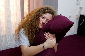 Palestinian teenager Ahed Tamimi, who was released from an Israeli prison on Sunday,holds her pillow as she poses for a photo in her room in Nabi Saleh village in the occupied West Bank