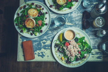 Three plates of salad in cafe