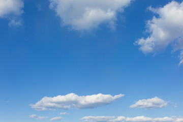 White clouds on blue sky background.