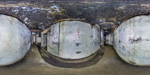 full seamless panorama 360 degrees angle view inside ruined abandoned military underground casemates fortress of the First World War in equirectangular spherical projection