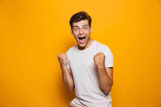 Portrait of an astonished young man celebrating success