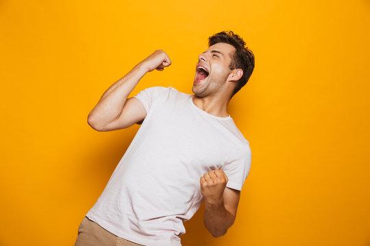 Portrait of a joyful young man celebrating