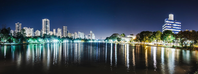 Panoramic photo of the Lago Igapo, Londrina - Parana, Brazil. View of the Igapo lake at night and the city, buildings on background. Leisure place, touristic destination of the city. Wall mural