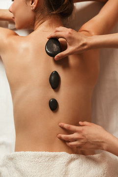Top view of a woman having hot stone massage