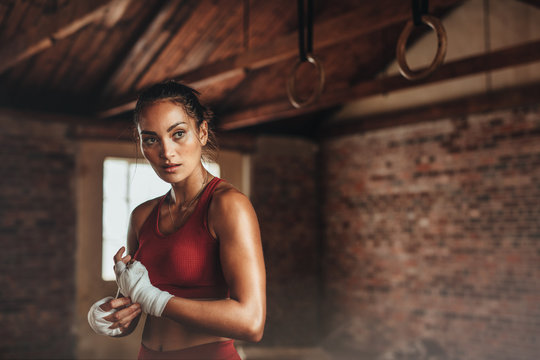 Female in shed preparing for boxing