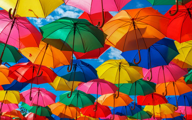 Lots of colorful umbrellas in the sky. City decoration