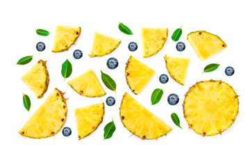 Flat lay of Sliced Pineapple, green leaves and berries isolated on white background. Fruit and Berry Pattern.