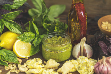 Fresh homemade pesto sauce close up and food ingredients