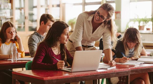 Teacher happy to help student