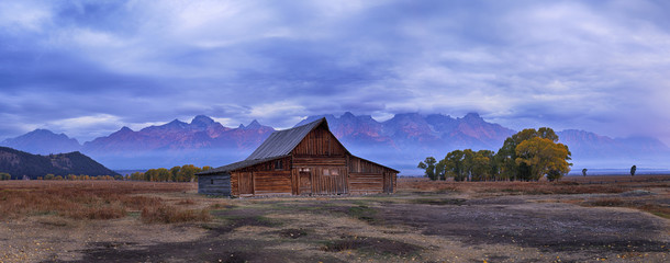Moulton Barn with Teton Range at Sunrise in Autumn, Grand Teton National Park, Wyoming, USA
