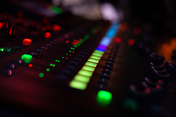 mixing console with blurred look live on stage