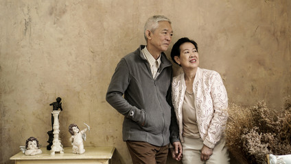 Happy Asian senior couple casual dress with sunglasses in vintage house