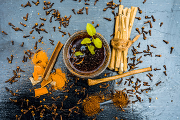 Effective and fiathful home remedy for toothache i.e. Sugar,water,cinnamon stick and whole cloves on wooden surface with neem bark or Indian lilac  bark brushes.