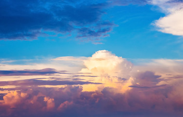 Sky with colorful curly clouds during sunset or sunrise_