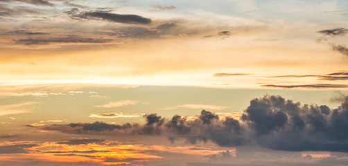 Picturesque multicolored clouds in the evening sky. Bright clouds during the sunrise. Panorama_