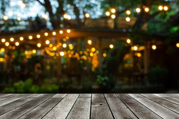 empty modern wooden terrace with abstract night light bokeh of night festival in garden, copy space for display of product or object presentation, vintage color tone