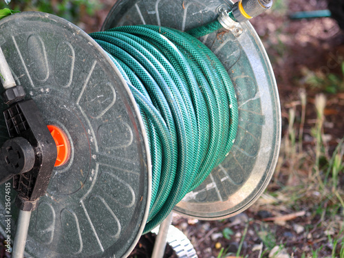 Green Gardening Hose For Watering Flowers And Gr Wred Around The Aluminum Carrier Garden Compressed Plants In