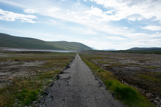 Looking eastwards at the bottom of Loch Glascarnoch and a road that is normally submerged and at the bottom of the loch