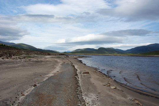 Looking westwards on a road next to Loch Glascarnoch.  The road is normally completely submerged under under Loch Glascarnoch