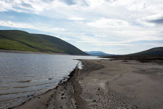 This is the old Dingwall to Ullapool road that was submerged on the creation of Loch Glascarnoch.  The road has reappeared due to low rain.  This shows the road entering the loch.