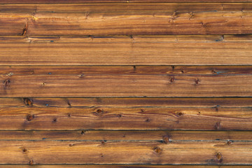 Brown-golden weathered wood cladding of a house wall No. 2