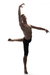 front view, one young man arms hand raised up, ballet dancer, standing on one leg in air, white background.