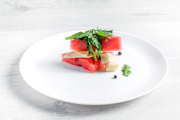 Watermelon salad with goat cheese and arugula