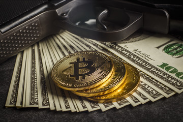 Gold coin in the form of bitcoin with dollars and a gun