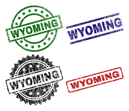 WYOMING seal stamps with corroded texture. Black, green,red,blue vector rubber prints of WYOMING label with corroded texture. Rubber seals with round, rectangle, medal shapes.