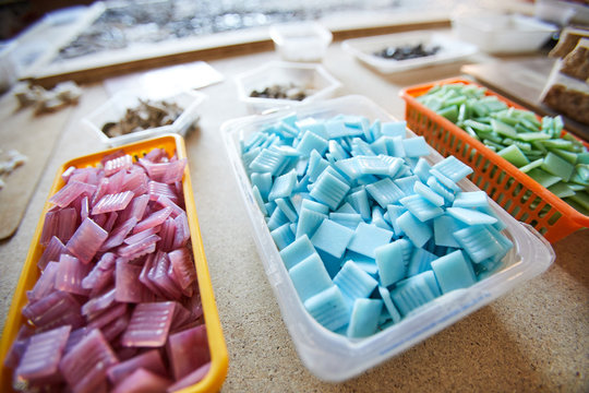 Close up shot of colored square tiles prepared for work in mosaic workshop